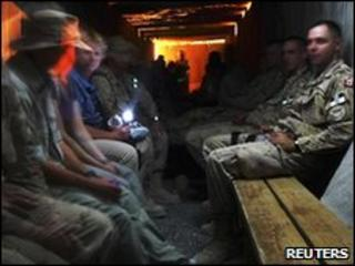 Isaf civilian and military staff in base shelter 22/05