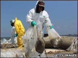 A BP clean-up crew removes oil from a beach in Louisiana