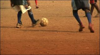 A ball being kicked and chased