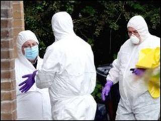 Forensic scientists examine scene