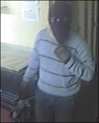CCTV still of robber