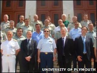 Professor Simon Payne and Professor David Wheeler with members of the Greek Military