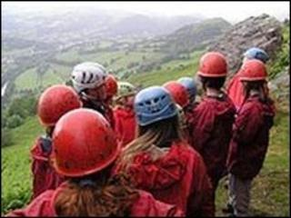 A school party takes part in mountaineering at Bryntysilio