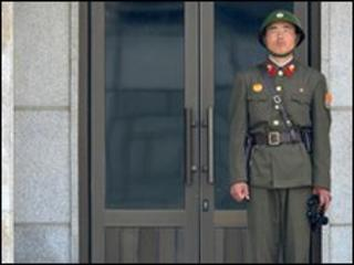 A North Korean soldier stands guard in the truce village on Panmunjom in the demilitarised zone on 2 June 2010