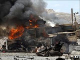 A Nato vehicle burns after a militant attack in Jalalabad, Afghanistan, 6 June 2010