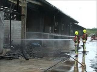Firefighters tackle barn fire
