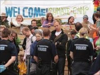 Campaigners and police face each other at the entrance of the Climate Camp in Hoo