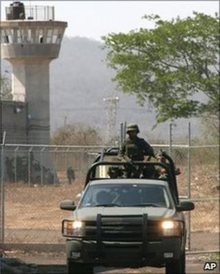Mexican army soldiers patrol outside the Mazatlan prison, Mexico, 14 June 2010