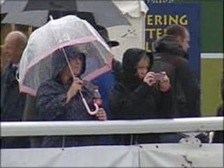 Show-goers watch in rain