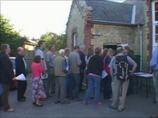 Villagers going to meeting in Hauxton