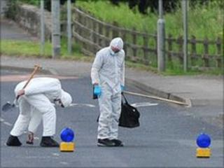Forensics officers at the scene of the alert