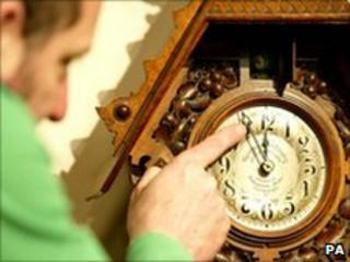 A man changing the time