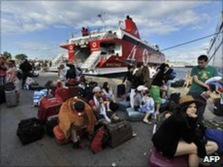 Tourists stranded in the port of Piraeus, Greece, 23 June 2010