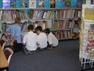 Schoolchildren in public library