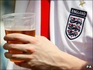 An England fan enjoys a drink