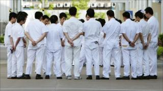Workers at a strike-hit Honda Lock plant in Zhongshan, Guangdong province, on 18 June 2010