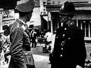 A Luftwaffe officer talks to a policeman in German-occupied St Helier, Jersey