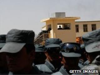 Afghan policemen attend a graduation ceremony in Dand, Kandahar, 10 June