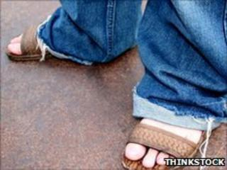 Man in jeans and sandals