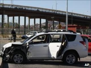 Wrecked car of murdered consular worker