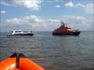 Motor cruiser under tow by Sheerness lifeboat