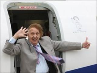 Ken Dodd outside the plane named after him