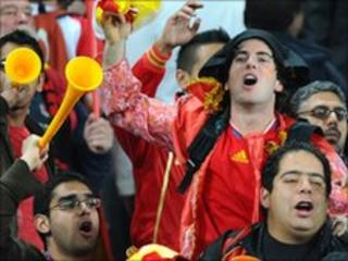 Supporters of Spain celebrate after the national football team defeated Germany 1-0 and qualified to the final of the 2010 World Cup, at Moses Mabhida stadium in Durban, South Africa