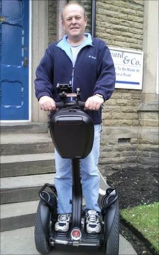 Philip Coates on his Segway scooter