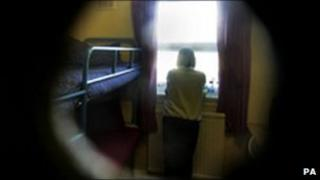 Female prisoner in cell