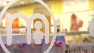Mothercare logo on window
