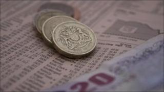 Cash on newspaper