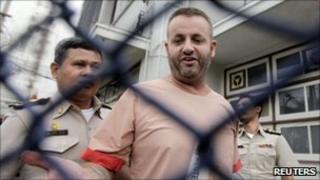 Jeff Savage walks from the court room at Pathumwan Municipal court in Bangkok