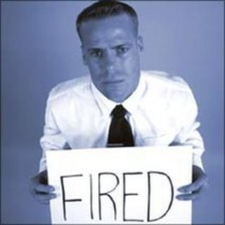 Man holds fired sign