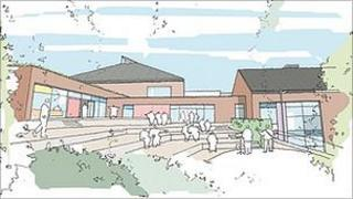 Artist's impression of plan for new school to replace Les Beaucamps