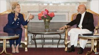 US Secretary of State Hillary Clinton and Afghanistan President Hamid Karzai met privately at the Presidential Palace in Kabul