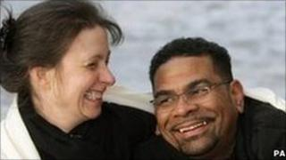 Debbie Purdy with her husband outside London's Royal Courts of Justice
