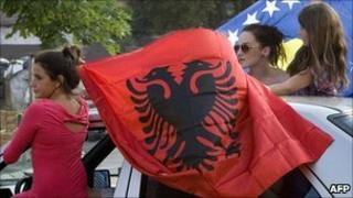 Kosovo Albanians celebrate the ruling in the divided city of Mitrovica