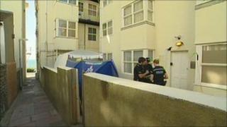 Police at the property in Marine Parade, Brighton