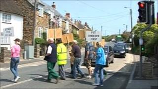 Protesters at a pelican crossing