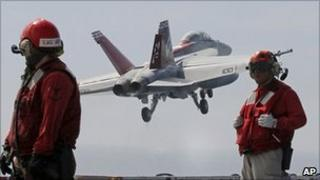 Plane takes off from the USS George Washington on 25 July 2010