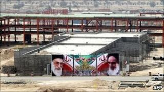 A banner - with portraits of Iran's supreme leader Ayatollah Ali Khamenei and his predecessor Ayatollah Ruhollah Khomeini - on a building being built in the South Pars gas field development in Asaluyeh