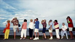 People take photographs