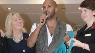 Ricky Whittle (centre) opens The Mall