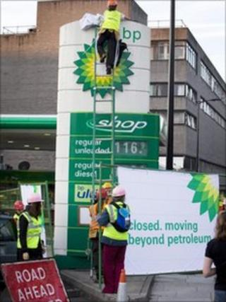 Greenpeace activists on a petrol station forecourt