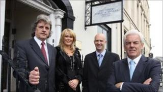 Solicitors Robert Ferguson and Norville Connolly flank Karen O'Callaghan and Damian Milligan from Ulster Bank