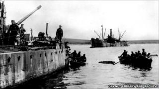 Crew of a German boat abandon ship in 1919 [Pic: Orkney Library and Archive]