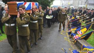 The coffin of Samuel Robinson is carried into St Mary's Church in Carmarthen