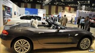 Indian delegates and staff look at BMW Z4s Drive35i on display at The Hyderabad International Auto Show 2010 at The Hyderabad International Convention Centre (HICC) in Hyderabad on July 22, 2010