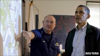 Barack Obama (R) and Thad Allen