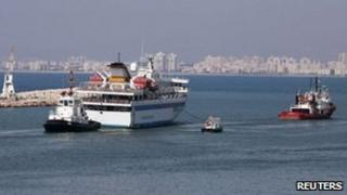 The Mavi Marmara is towed out of Haifa, 5 August